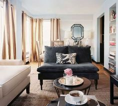 Mismatched furniture, small coffee tables, oversized windows.