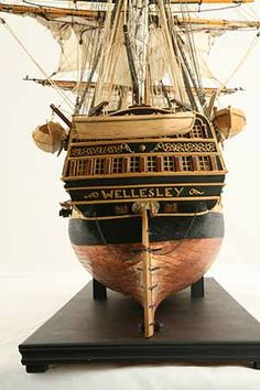 Close-up photos of ship model HMS Wellesley. HMS Wellesley was launched at Bombay in 1815 as a 74 gun ship. Bear Tattoos, Ship Tattoos, Gun Tattoos, Ankle Tattoos, Arrow Tattoos, Word Tattoos, Model Ship Building, Old Sailing Ships, Model Boat Plans