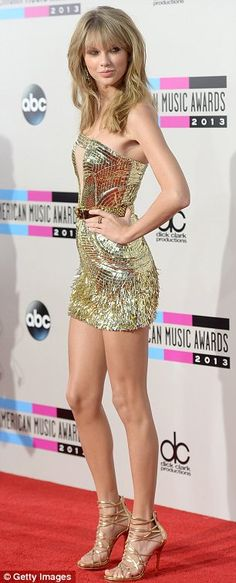 Taylor Swift Mini Skirt | Taylor Swift picks up four awards at the AMAs... and her strapless ...