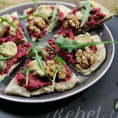 Buckwheat flatbread #pizza with beetroot hummus and cashew cheese. Find the recipe on @rebelrecipes' blog.