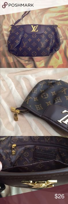 Elegant wristlet Beautiful and classy brand new never used- removable straps Louis Vuitton Bags Clutches & Wristlets