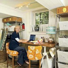A sawhorse desk and store-bought steel shelves create a comfy Cottage-style office in this basement budget redo.   Photo: Deborah Whitlaw Llewellyn   thisoldhouse.com