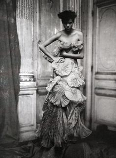 pleats - feathers - attitude. Wow. (Photo by Paolo Roversi, Vogue Italia, March 2008)