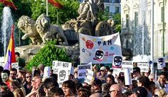 """Demonstrators hold signs as they protest in front of Cibeles fountain against the public security law """"ley mordaza"""", or """"gag law"""" in Madrid on June 30, 2015. Photo:AFP"""