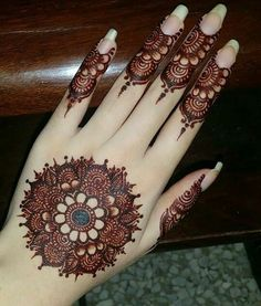 Mehndi henna designs are always searchable by Pakistani women and girls. Women, girls and also kids apply henna on their hands, feet and also on neck to look more gorgeous and traditional. Henna Hand Designs, Dulhan Mehndi Designs, Mehandi Designs, Round Mehndi Design, Mehndi Designs Finger, Mehndi Designs For Girls, Mehndi Designs For Beginners, Modern Mehndi Designs, Mehndi Design Photos