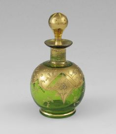 """Moser glass scent bottle. Parcel gilt green glass with original stopper, 4"""" tall."""