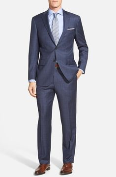 This is the style of suit that the guys will wear in a similar shade of 100% worsted wool blue called Navy Fancy. Hart Schaffer Marx New York Modern Fit Model 83D- 2 button, side vent, notch lapel, pick stitching, besom/flap pockets, flat front trouser (no cuffs). They will wear crisp white traditional collar shirts with pale pink ties and black cap toe lace up dress shoes.