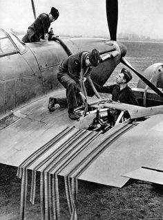 Armed with caliber Browning machine guns, a British Hawker Hurricane being loaded with ammunition and fuel: Battle of Britain Aircraft Photos, Ww2 Aircraft, Military Aircraft, Hawker Hurricane, Ww2 Planes, Battle Of Britain, Royal Air Force, Luftwaffe, Military History