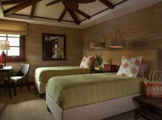 The connecting upholstered headboard allows the twin beds to be converted into a king.  www.hendersondesigngroup.net