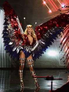 Miss USA's Olivia Jordan flashed the crowd a peace sign as she stepped out in a fringed garment, which proudly displayed the colour's of her country's national flag