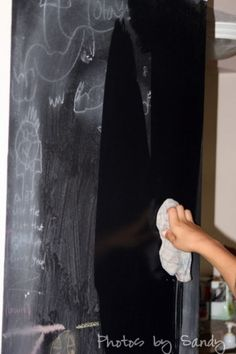 cleaning a chalkboard painted wall
