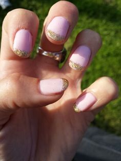 Baby pink nails with gold glitter tips