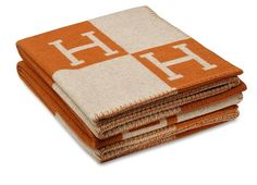 The one over-the-top indulgence in the room is an Hermès Wool and Cashmere Blanket in the luxury label's trademark shade of orange; $1,125 directly from Hermès
