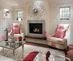 pink living room with blue fireplace