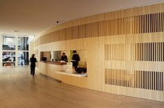 12 Design-Differentiated Floors Linked Together in Hotel Puerta América/ Reception desk and meeting rooms by John Pawson