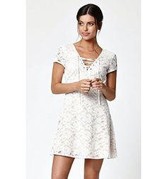 #Kendall & #Kylie enhance your wardrobe with a sweet and feminine style. The Lace-Up Front Short Sleeve Dress has a white lace construction, an A-line skirt, and ...