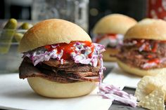 Pork tenderloin sandwiches with red cabbage coleslaw and sriracha