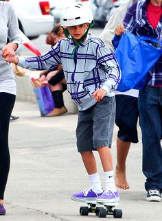Celeb Kids' Hottest Back to School Fashions: Romeo Beckham's zip-up hoodie is perfect for any young skateboarder.