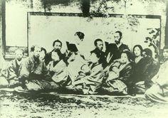 Japanese antique photograph. Matsudaira Katamori (1836-1893).   Katamori and him vassals. The child and wife of vassals appear in the photograph, too.    Edo era.