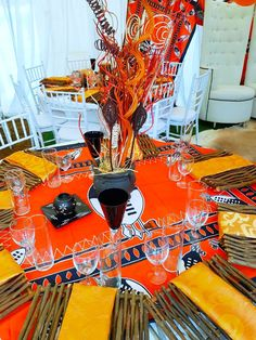 Orange and black Swazi traditional wedding decor at Shonga Events wedding – Outdoor Wedding Decorations 2019 African Wedding Theme, African Theme, African Wedding Dress, Traditional Wedding Decor, African Traditional Wedding, Outdoor Wedding Decorations, Table Decorations, Centerpieces, African Accessories