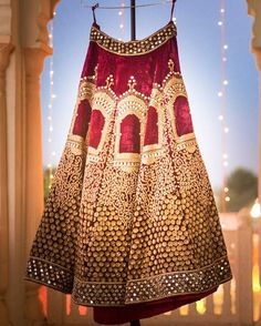 """""""We are crushing over bride Abhilasha Meena's velvet lehenga with jharokha details in gold embroidery by @asianacouture_delhi. Photo Courtesy-…"""""""