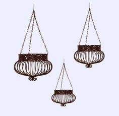 """Set of 3 Victorian Hanging Planters Wrought Iron Rust by Americana-R-Us. $103.70. Set of 3. Victorian Design. Hanging Planters. Rust Finish. Wrought Iron. Set Of 3 Victorian Hanging Basket Planters Wrought Iron in a Antiqued Rust Finish. The Baskets measures as follows: Large Victorian Hanging Basket 36 """" High counting chain x 18 """" in diameter widest point, Medium Victorian Hanging Basket 28 1/2 """" High counting chain x 13 """" in diameter widest point and Small Victorian Hanging B..."""