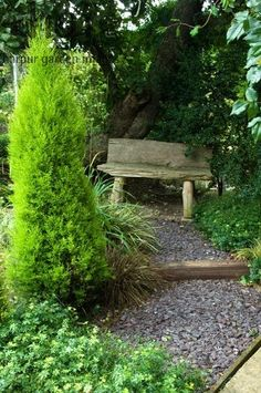 rustic log bench. I want one in my oak grove.