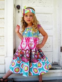 darling dress using Amy Butler fabric OMG @Stephanie Champ Ngugi I could see both J and L wearing this!