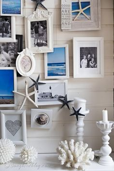 Here is my summer beach mantel. I added sea images to a layered photo frame gallery and added beach accessories for summer decoration in blue and white. www.songbirdblog.com