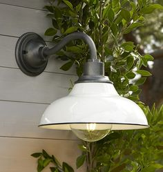 White industrial farmhouse modern exterior entryway light. Consider two flanking the front door.