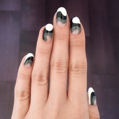 Swirled white, grey + black nail art