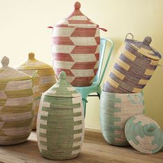 These Graphic Lidded Baskets ($149 each) share the same earthy, modern aesthetic. Try using them for a stylish laundry stash.