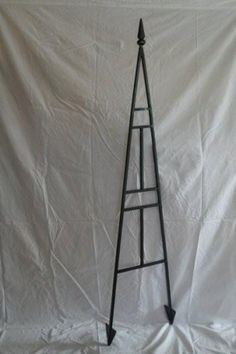 5 Foot High Handmade, Solid 1/2 Inch Steel Trellis by Roberto Iron Works. $159.99. 5 Foot high handmade in th USA, solid ½ inch steel trellis for your garden. Strong angled feet can be hammered into ground for easy install. Finished in hammered iron black (can be custom painted for additional charge).