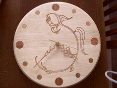 Clock with mahogany inlay.