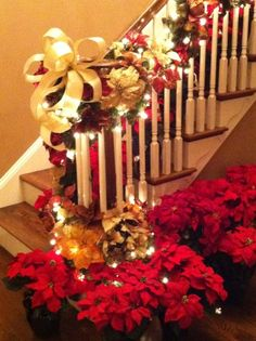 Home-made bow, poinsettia's and string of lights can create a holiday wonderland! #Christmas decorating