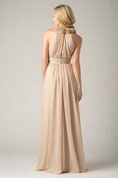 Take a stylish step out of the ordinary in this unique WTOO Maids 804 bridesmaid dress. Crafted in flowing Crystal Chiffon, the bodice is shirred and wrapped, with a plunging V-neckline and a halter of fabric carnation flowers encircling the back of the neck. A matching cummerbund style band enhances the natural waistline, giving way to a gathered A-line skirt. Full length and formal, this gown stuns from every angle, with a chic slit back and taken in shoulders. An invisible zipper clos...
