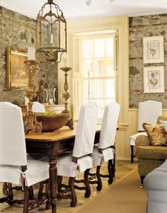 love the combination of stone walls with ivory colored woodwork and wood floors.  (I don't care for the chairs)