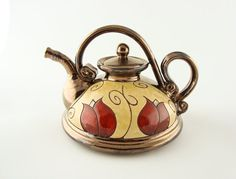 This teapot ishandmade in small art pottery studio in eastern europe.    Made of black clay and hand carved design.    The teapot is perfectly