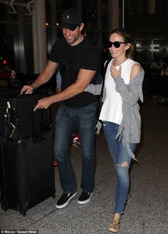 No jet-lag there! The attractive pair were seen laughing and joking as they made their way to a waiting car