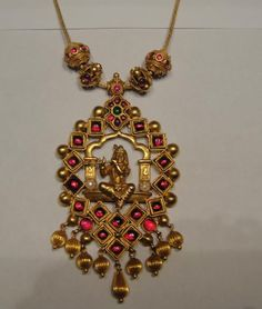Simple antique finish temple jewellery necklace with Lord Krishna pendant studded with rubies and emeralds. India Jewelry, Temple Jewellery, Antique Necklace, Antique Jewelry, Antique Gold, Gold Jewelry Simple, Gold Jewellery Design, Diamond Jewellery, Schmuck Design