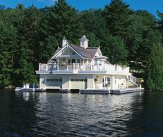 "Boathouse Cottage    A retreat that takes full advantage of the water's edge.      Homeowners Tom and Suzanne White's boathouse on Lake Rosseau has a ""Muskoka Victorian"" architectural style. It's defined by Victorian-influenced features, including substantial window casings, wraparound porches and bay windows."