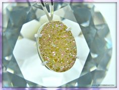 "It's hard to capture in a photograph the sparkle and the color shift in this stone.  It looks yellow-ish here, but it shows pink and greens in person.  This drusy quartz pendant is approx.17x12mm.   The gemstone sparkles and appears to change color when mobile.   An 18"" sterling silver box chain w/ spring ring clasp is also included in purchase.   Drusy quartz is color treated.   Handcrafted and unique from RICCI Designs.  $32.99 with Free shipping on all orders  WWW.RICCIDESIGNS.COM"