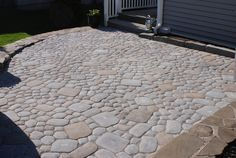 Pave- Driveway: We offer a full selection of paver patios, walkways and driveways in different formal and natural patterns and colors.