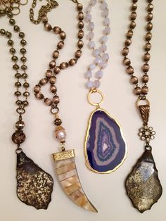 Spring is here!! One of a kind necklaces with mother of pearl horn, vintage glass pendants, gorgeous purple agate slice with vintage glass pearls and pyrite and lace agate. Email lisajilljewelry@gmail.com
