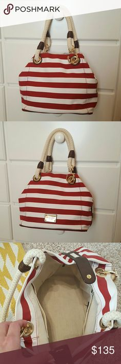 [Michael Kors] Red Nautical Bucket Tote Beautiful, red and white striped canvas bucket tote. Gold hardware with anchor detail- super cute! Rope handles, wrapped in brown leather. Superior clean interior and exterior, almost flawless bottom. Four sewn pockets and one larger zipper pocket on inside. Only a minor sign of carry on handle. This bag is practically brand new! A wonderful carry for the upcoming spring season- this is your bag! Michael Kors Bags