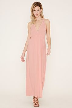 A sleeveless woven maxi dress with an elasticized waist and crochet trim at its deep V-neckline and T-back.