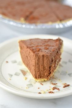 Rich No Bake Chocolate Truffle Pie is the perfect dessert recipe for a holiday party or to enjoy at home. Made with a graham cracker crust.