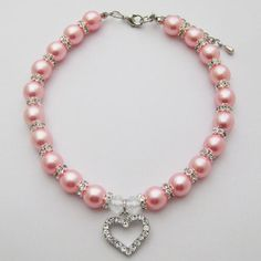 """PETFAVORITESâ""""¢ Couture Designer Fancy Engraved Crystal Heart Pet Cat Dog Necklace Jewelry with Bling Pearls Rhinestones Charm Pendant for Pets Cats Small Dogs Female Puppy Chihuahua Yorkie Girl Costume Outfits, Adjustable and Handmade (Pink, Neck Size: 12\""""-14\"""") *** You can find out more details at the link of the image."""