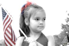 girl holding the american flag
