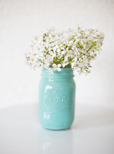 Mason Jar Makeover with wild spring flowers--perfect for a budget friendly, rustic/chic wedding.  Just pour some acrylic paint in the jar, shake to coat and let dry.  Original idea from Flutter Magazine.